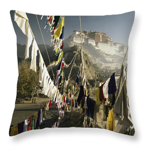 Asia Throw Pillow featuring the photograph Prayer Flags Hang In The Breeze by Gordon Wiltsie