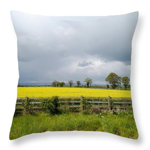Canola Field Throw Pillow featuring the photograph Rain Clouds Over Canola Field by Christiane Schulze Art And Photography