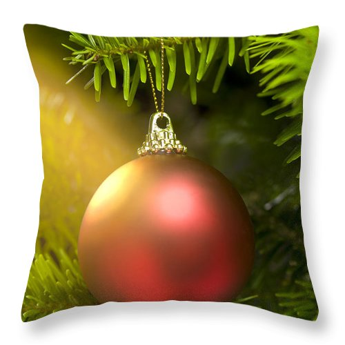 Advent Throw Pillow featuring the photograph Red Ball In A Real Caucasian Fir Christmas Tree by U Schade