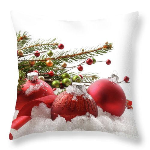 Backgrounds Throw Pillow featuring the photograph Red Christmas Balls In The Snow by Sandra Cunningham