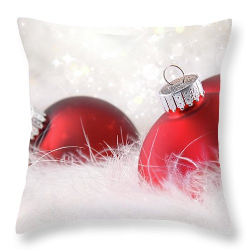 Abstract Throw Pillow featuring the photograph Red Christmas Balls In White Feathers by Sandra Cunningham