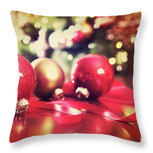 Backdrop Throw Pillow featuring the photograph Red Christmas Ornaments With Vintage Look by Sandra Cunningham