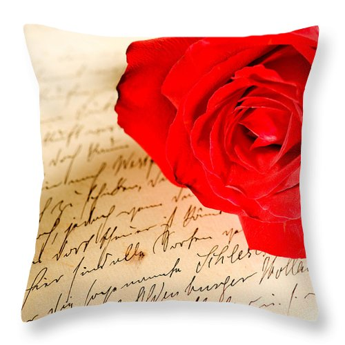 Alliance Throw Pillow featuring the photograph Red Rose Over A Hand Written Letter by U Schade