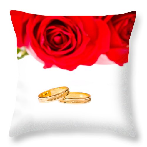 Backgrounds Throw Pillow featuring the photograph Red Roses And Wedding Rings Over White by U Schade