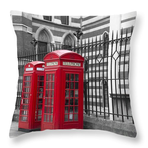 Red Telephone Boxes Outside The Law Courts In London Bw Throw Pillow featuring the photograph Red Telephone Boxes by David French