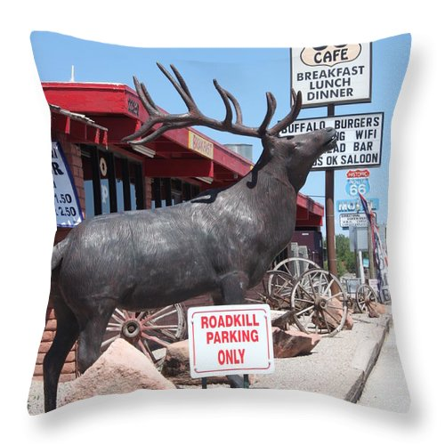 Roadkill Cafe Throw Pillow featuring the photograph Roadkill Cafe by Caroline Lomeli
