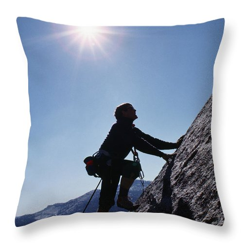 Yosemite Throw Pillow featuring the photograph Rock Climber On Polly Dome Above Lake by Gordon Wiltsie