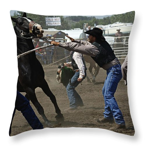 Rodeo Throw Pillow featuring the photograph Rodeo Wild Horse Race by Bob Christopher