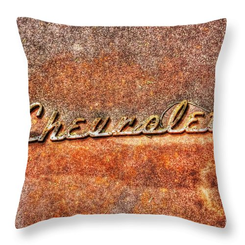 Old Throw Pillow featuring the photograph Rusted Antique Chevrolet Logo by Dan Stone
