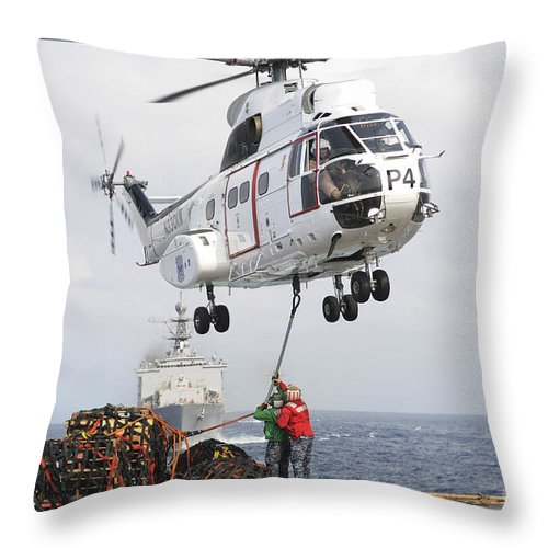 Navy Throw Pillow featuring the photograph Sailors Hook Up A Pole Pendant by Stocktrek Images