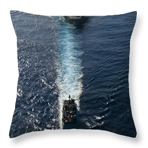 Uss John C Stennis Throw Pillow featuring the photograph Ships From The John C. Stennis Carrier by Stocktrek Images
