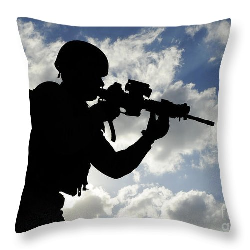 Security Operations Throw Pillow featuring the photograph Silhouette Of A Soldier by Stocktrek Images
