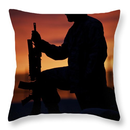 Sandbag Throw Pillow featuring the photograph Silhouette Of A U.s Marine On A Bunker by Terry Moore