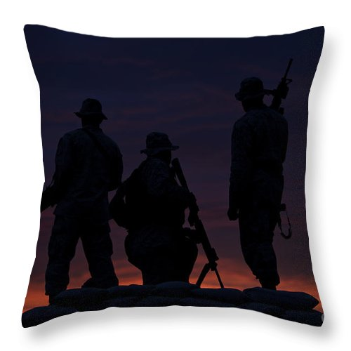Marine Throw Pillow featuring the photograph Silhouette Of U.s Marines On A Bunker by Terry Moore