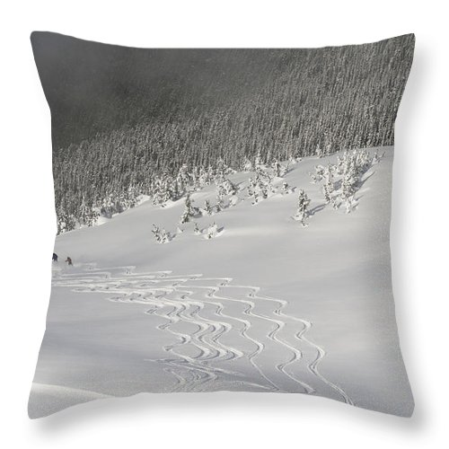 Adventure Throw Pillow featuring the photograph Skiers At The Base Of A Mountain by Keith Levit