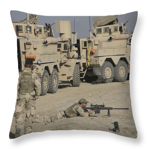 Vehicle Throw Pillow featuring the photograph Soldier Fires A Barrett M82a1 Rifle by Terry Moore