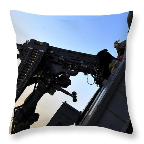 Hh-60 Pave Hawk Throw Pillow featuring the photograph Soldier Mans The .50 Caliber Machine by Stocktrek Images