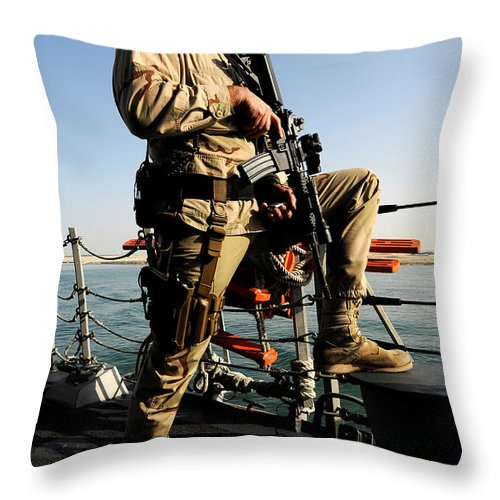 Operation Enduring Freedom Throw Pillow featuring the photograph Soldier Stands Watch Aboard Uss Momsen by Stocktrek Images