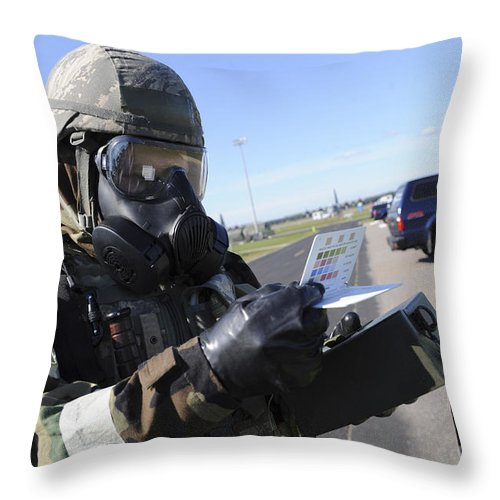 Military Throw Pillow featuring the photograph Soldier Uses An M256 Kit To Identify by Stocktrek Images