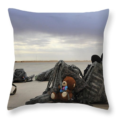 Iraq Throw Pillow featuring the photograph Soldiers Backpacks On The Flight Line by Stocktrek Images