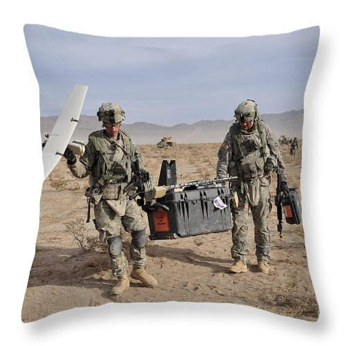 Military Throw Pillow featuring the photograph Soldiers Carry An Rq-11 Raven Unmanned by Stocktrek Images