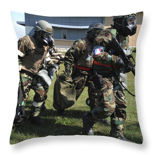 Military Throw Pillow featuring the photograph Soldiers Dressed In Chemical Warfare by Stocktrek Images