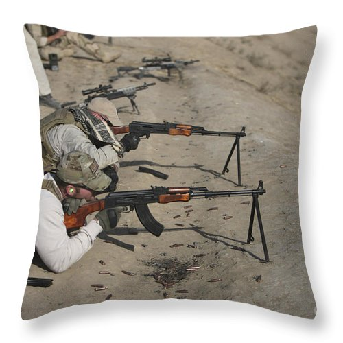 Cartridge Throw Pillow featuring the photograph Soldiers Fire A Russian Rpk Kalashnikov by Terry Moore