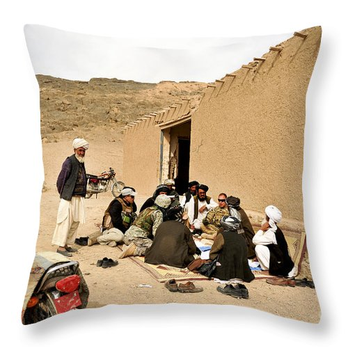 Provincial Reconstruction Team Throw Pillow featuring the photograph Soldiers Speak With School Teachers by Stocktrek Images