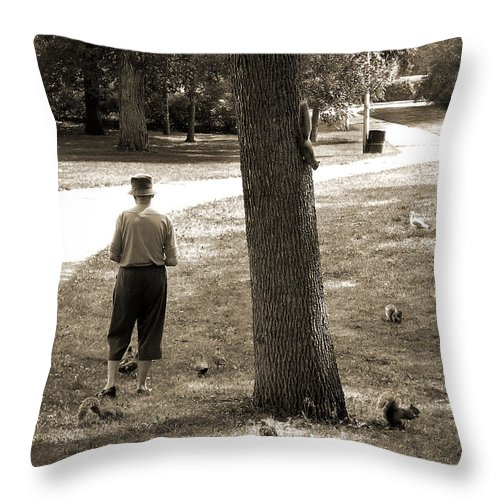 Squirrels Throw Pillow featuring the photograph Squirrel Lady by Burney Lieberman