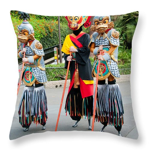 Colourful Throw Pillow featuring the digital art Stiltwalkers by Carol Ailles