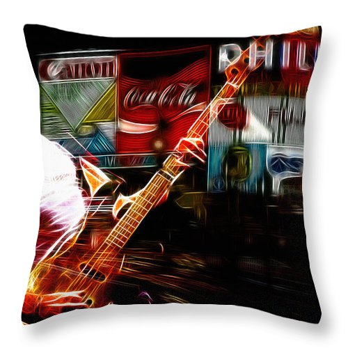 Sting Music Man Male Famous Star Police Gordon Rocks Rock Pop London Piccadilly Circus Neon Light Guitar Hero Playing Rocking Lights Bus Underground City Cityscape Throw Pillow featuring the digital art Sting Rocks London by Steve K