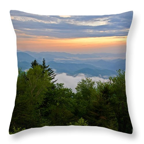 Sunset Throw Pillow featuring the photograph Stormy Sunset by Bob and Nancy Kendrick