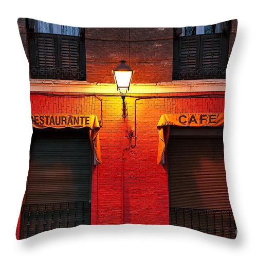 Madrid Throw Pillow featuring the photograph Street Lamp Cafe by John Greim