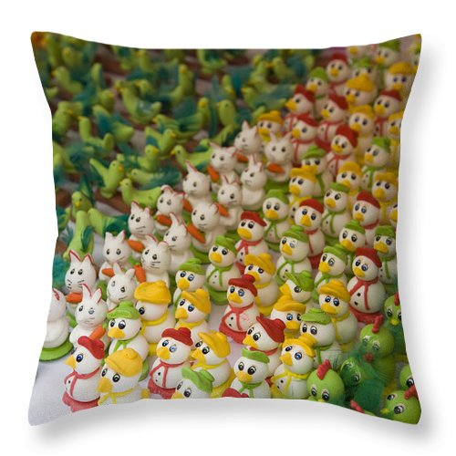 Color Image Throw Pillow featuring the photograph Sugar Figurines For Sale At The Day by Krista Rossow