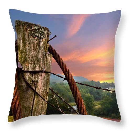 Andrews Throw Pillow featuring the photograph Sunrise Lasso by Debra and Dave Vanderlaan