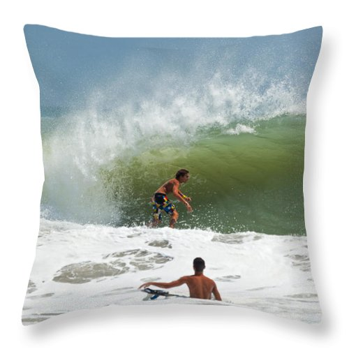 Wave Throw Pillow featuring the photograph Surfing In The Wake Of Hurricane Irene by Michelle Constantine