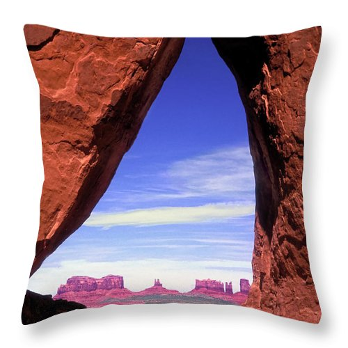 Teardrop Arch Throw Pillow featuring the photograph Teardrop Arch Monument Valley by Dave Mills