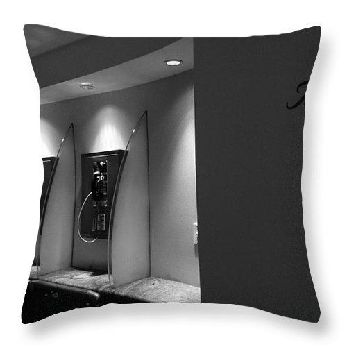 Apparat Throw Pillow featuring the photograph Telephones On Wall by Nina Prommer