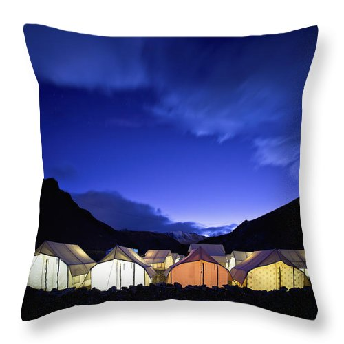 Blue Sky Throw Pillow featuring the photograph Tents Illuminated In A Valley At Night by David DuChemin