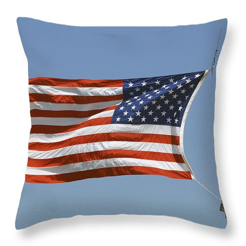 Waving Throw Pillow featuring the photograph The American Flag Waves At Half-mast by Stocktrek Images