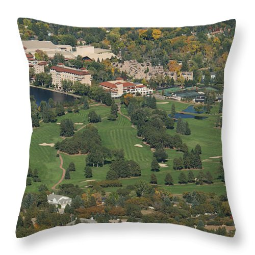 The Broadmoor Throw Pillow featuring the photograph The Broadmoor by Ernie Echols