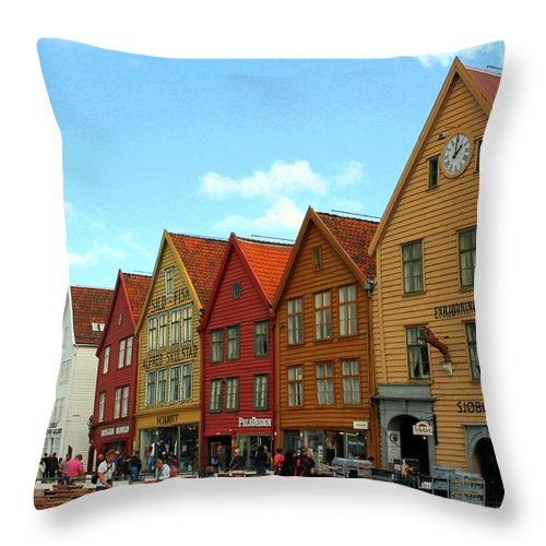 Bryggen Throw Pillow featuring the photograph The Bryggen District Of Bergen by Laurel Talabere