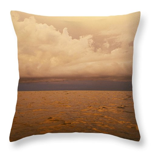 Atlantic Ocean Throw Pillow featuring the photograph The Caribbean Sea Reflects The Sunset by Stephen Alvarez