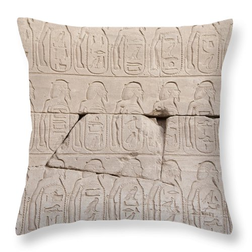 Africa Throw Pillow featuring the photograph The Figures Of Prisoners On A Temple by Taylor S. Kennedy