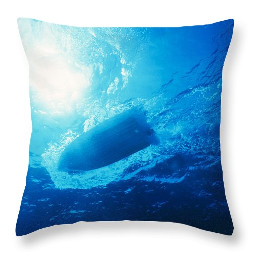 Speed Boat Throw Pillow featuring the photograph The Hull Of A Speed Boat Dingy Races by Jason Edwards