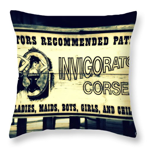 Corsets Throw Pillow featuring the photograph The Invigorator by Susanne Van Hulst