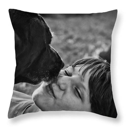 Black Lab Throw Pillow featuring the photograph The Kiss by Roger Wedegis