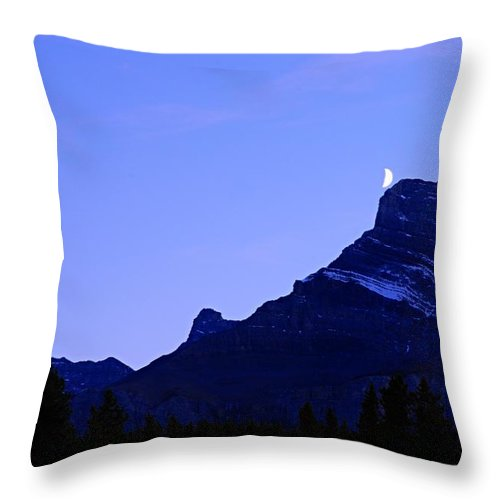 Mount Rundle Throw Pillow featuring the photograph The Moon And Mount Rundle by Larry Ricker