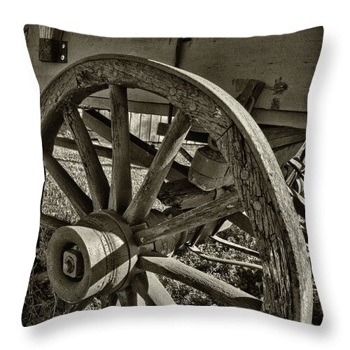 Black And White Throw Pillow featuring the photograph The Wagon Wheel by James Woody