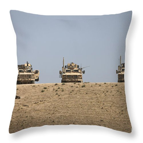 Machine Guns Throw Pillow featuring the photograph Three M-atvs Guard The Top Of The Wadi by Terry Moore